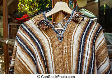 Traditional Chilean coat on hanger for sale in the market