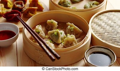 Traditional chinese dumplings served in the wooden bamboo...