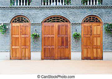 Traditional Chinese  house with wooden arch doors and deck.