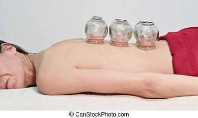Traditional Chinese Medicine therapy. Cupping therapy, a treatment used for pain relief and other health benefits .