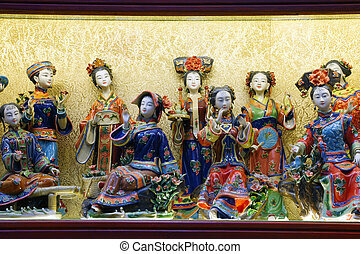 Traditional chinese miniature figurines in a souvenir shop....