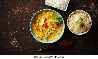 Traditional Chinese or Thai chicken yellow curry with...
