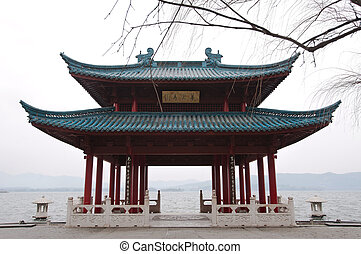 Traditional Chinese pavilion on the shore of West Lake,...