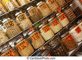 Traditional Chinese shop selling ingredients for food and...