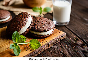 Traditional chocolate Whoopie pies filled with vanilla butter cream