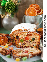 Traditional Christmas cake with nuts, candied fruit, raisins and fruits. Fruitcake. Selective focus
