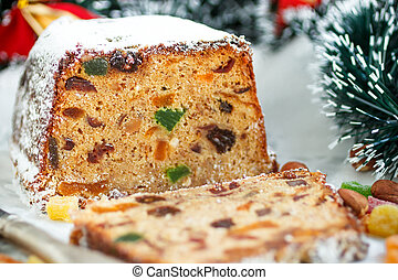 Traditional Christmas cake with nuts, candied fruit, raisins...