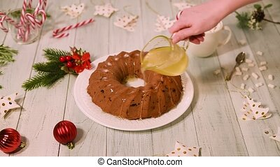 Traditional Christmas fruit cake on a white wooden table....