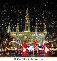 Traditional Christmas market with snow, Rathausplatz Rathaus...