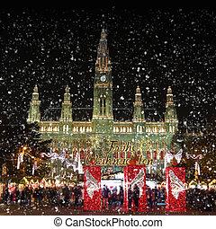 Traditional Christmas market with snow, Rathausplatz Rathaus...