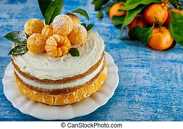 Traditional christmas naked cake with fresh mandarins.