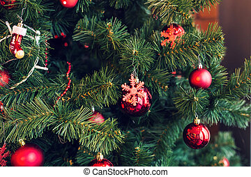 Traditional christmas or new year decorated tree with a snowflake toy