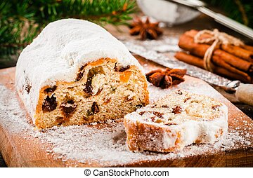 Traditional christmas stollen fruit cake on wooden rustic ...