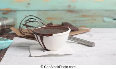 Traditional churros with hot chocolate dipping sauce on...