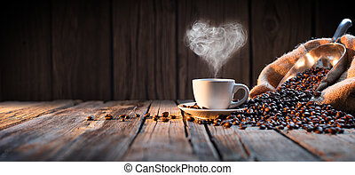 Traditional Coffee Cup With Heart-Shaped Steam On Rustic Wood