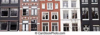 Traditional color contrasted dutch buildings in Amsterdam