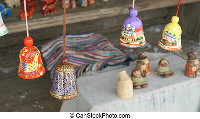 Traditional colorful festive wooden bells ringing -...