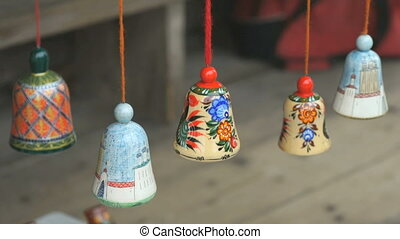 Traditional colorful festive wooden bells ringing