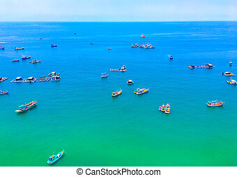 fishing boats in the azure sea