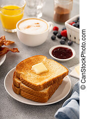Traditional continental breakfast with toast, butter and jam