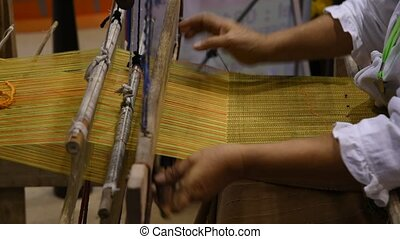 Traditional cotton woven. - Hands of woman weaving...