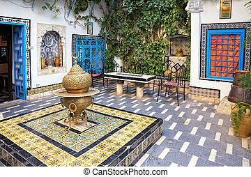 courtyard at Sidi Bou Said, Tunis, Tunisia - traditional...