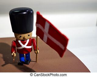 Traditional Danish Royal Guard toy soldier with flag of Denmark