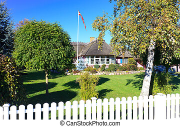 Traditional Danish summerhouse with flag flying high