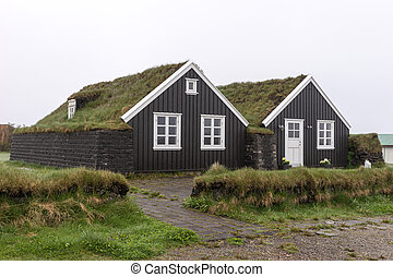 Traditional dark Icelandic houses with grass roof