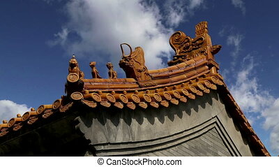 Traditional decoration of the roof of a Buddhist temple,...