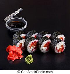 Traditional delicious fresh tobiko sake sushi roll set on a ...