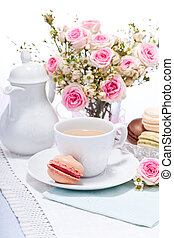 traditional delicious sweet dessert macarons and coffee on table
