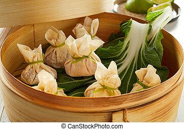 Traditional dim sum dumplings in bamboo basket