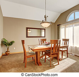 Traditional dinning room with carpet, in beautiful northwest...