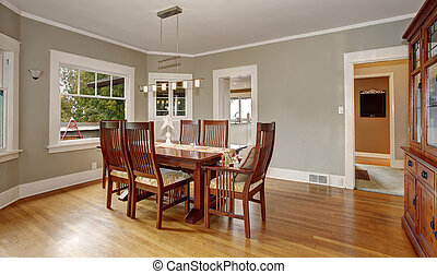 Traditional dinning room with hardwood floor, and hanging...