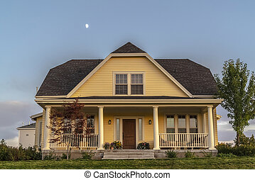 Traditional double storey timber clad yellow house