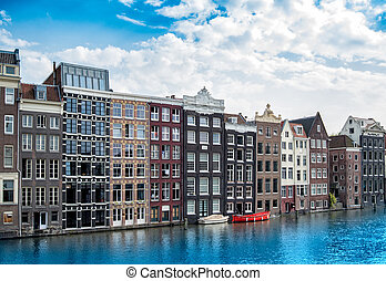 Traditional Dutch architecture on the background of a morning blue sky