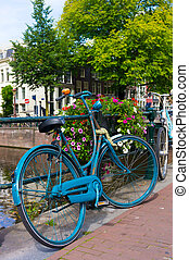 Traditional dutch bicycle parked on canal in Amsterdam