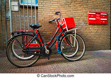 Traditional dutch bicycles parked on near brick wall in Amsterdam