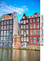 Traditional dutch buildings . canal in Amsterdam
