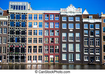 Traditional dutch buildings on canal in Amsterdam, Netherlands