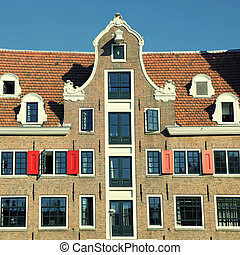 Traditional dutch medieval building in Amsterdam, Netherlands