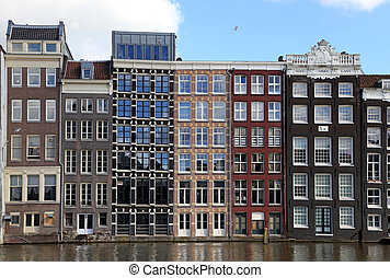dutch medieval buildings on canal in Amsterdam