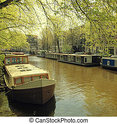 traditional dutch old buildings and houseboats in the canal, Amsterdam, the Netherlands