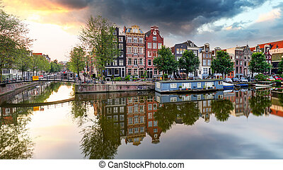 Traditional Dutch old houses on canals in Amsterdam, Netherland.