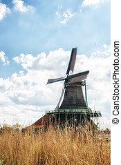 Traditional Dutch old wooden Windmills in Zaanse Schans - museum village in Zaandam, The Netherlands.