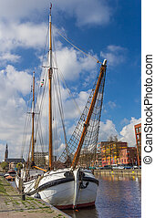 Traditional dutch sailing ship in the east harbor of Groningen
