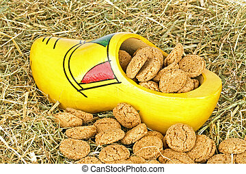 Traditional dutch wooden clog with gingernuts in straw for 5...
