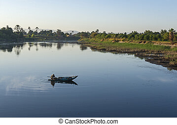 Traditional egyptian bedouin fisherman on river
