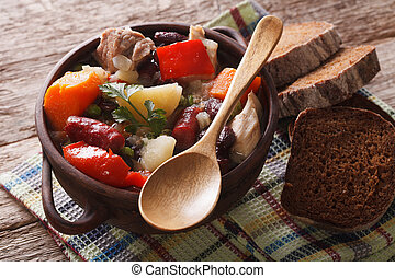 Traditional eintopf soup with meat, sausages and vegetables...